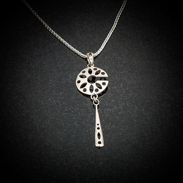 Fen Pendant by Patricia Dudgeon Designs Delicate cut out roundel and long dropper pendant in Hallmarked Sterling silver complete on chain.
