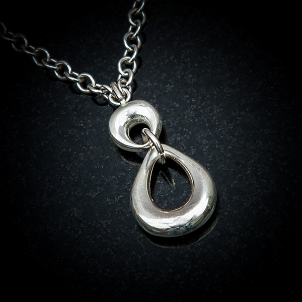 Papana Pendant by Patricia Dudgeon Designs.Abstract shaped top and teardrop shaped dropper make a classic styled pendant complete with chain.