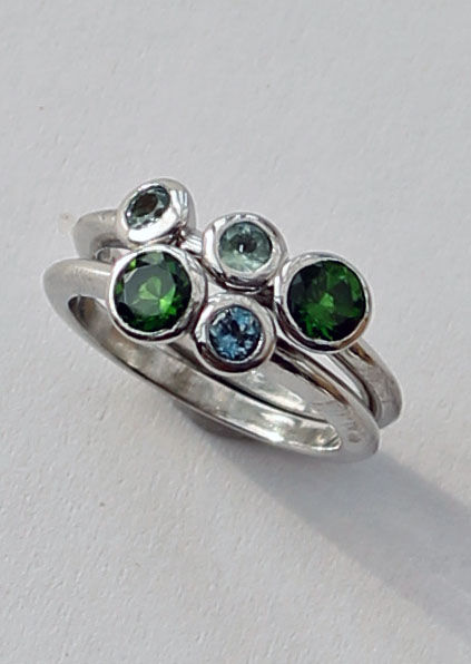 Chrome Diopside, Aquamarine and Alexandrite 9ct white gold ring by Patricia Dudgeon This is a double band ring set with an unusual combination of stones.