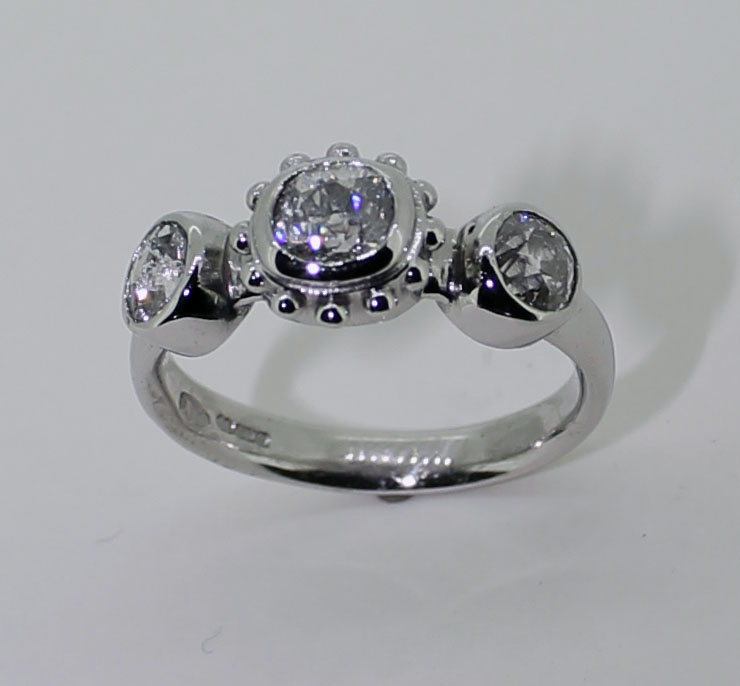 Palladium and 3 diamond beaded central setting ring