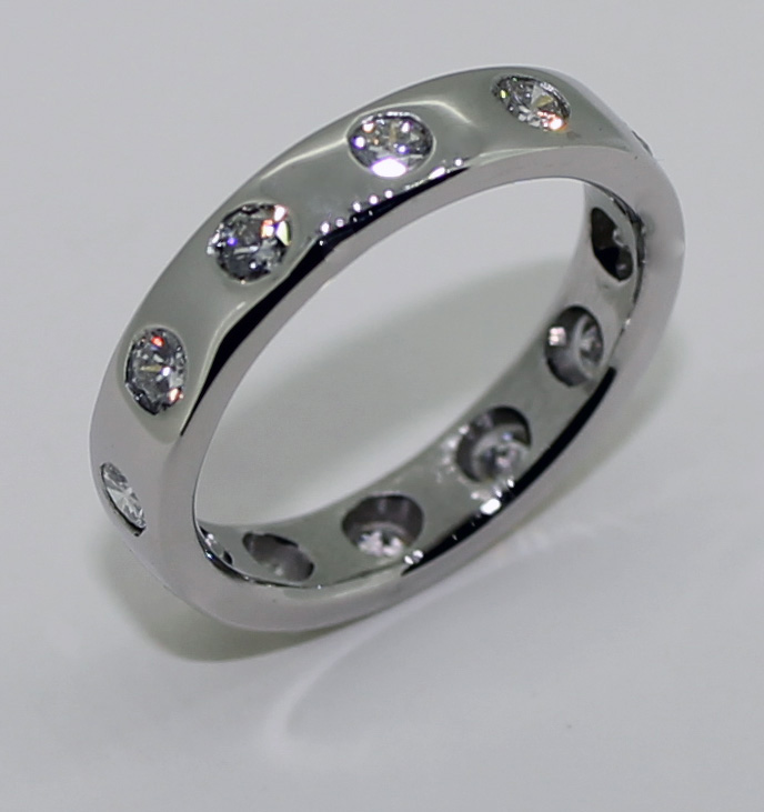 Platinum and diamond gypsy set band wedding ring