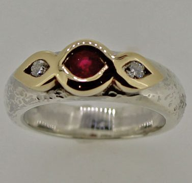 ruby and diamond hammered silver shank and gold setting