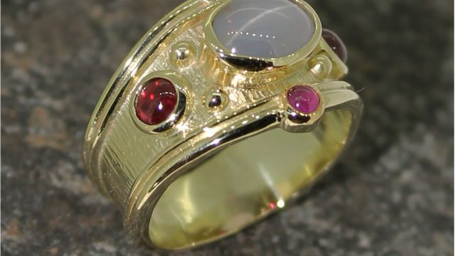 18ct star sapphire and ruby ring