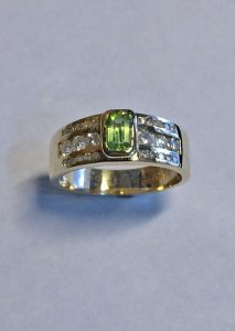 rectangle peridot and channel set diamonds ring