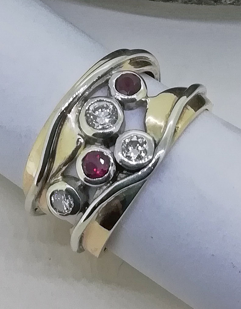 Ruby and diamond yellow and white gold ring